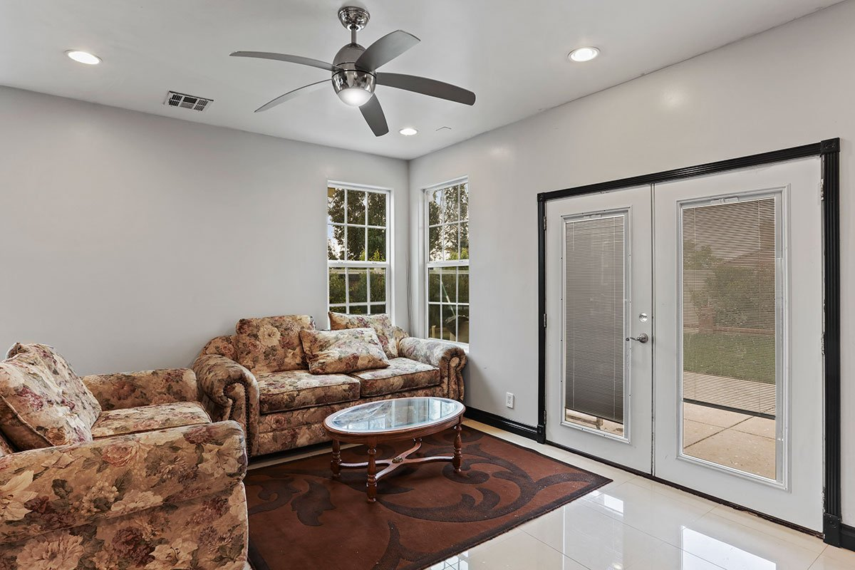 real estate for sale in west palmdale family room and rear french doors